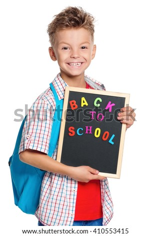 Happy boy with backpack and small blackboard isolated on white background. Back to school.