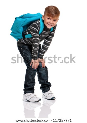 Happy boy with backpack isolated on white background