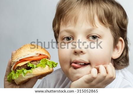 happy boy with burger - stock photo
