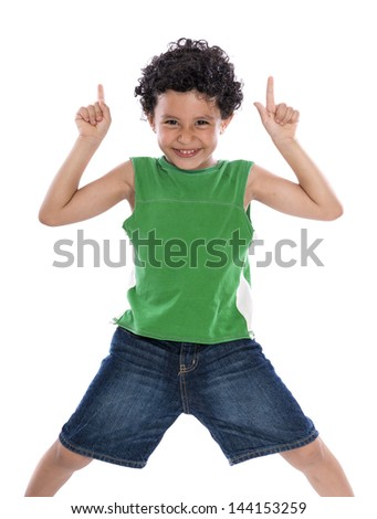 Happy Boy with Fingers Pointing Up over White Background - stock photo