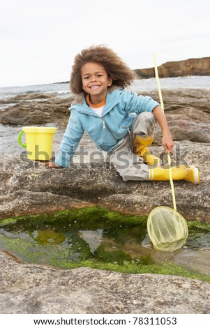 Happy boy with fishing net - stock photo