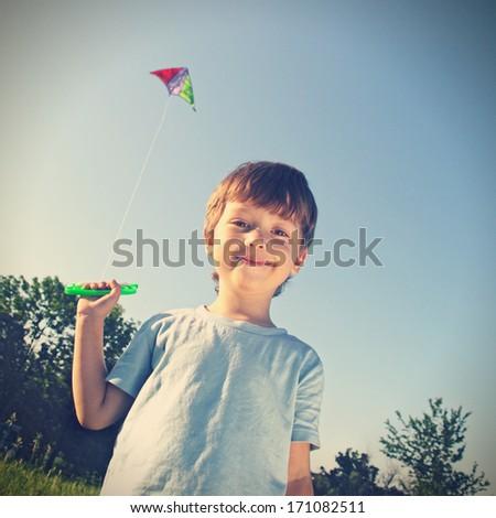 happy boy with kite - stock photo