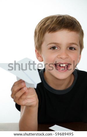 HAppy Boy with Paper Airplane - stock photo