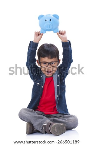 Happy boy with piggy bank on a white background - stock photo