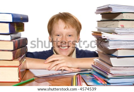 happy boy with pile of books
