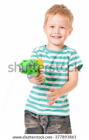 Happy boy with plastic water gun isolated on white background