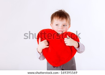 happy boy with red heart in hand,   valentine's day concept. closeup - stock photo