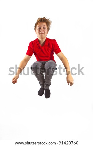 happy boy with red shirt jumping
