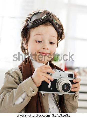 happy boy with retro camera - stock photo
