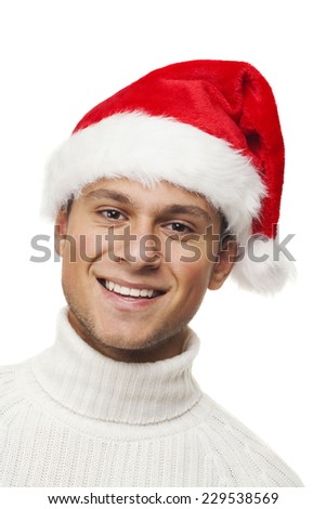 Happy boy with santa hat - stock photo
