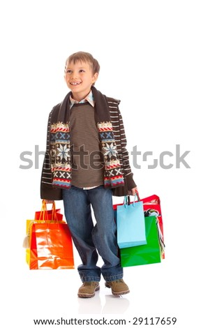 Happy Boy With Shopping Bags - stock photo