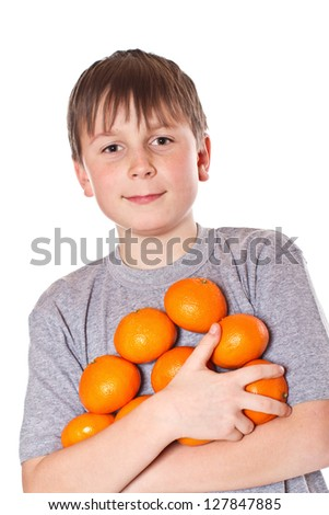happy boy with tangerines on a white background - stock photo