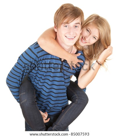 happy boyfriend giving girl a piggyback, white background - stock photo