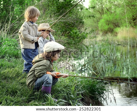 happy boys go fishing on the river