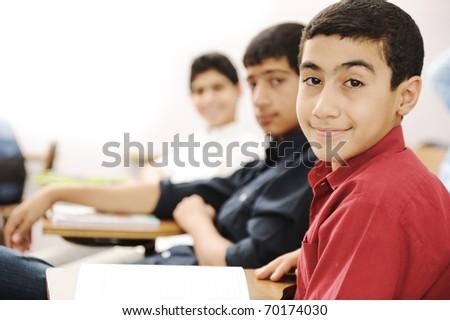Happy boys kids in the school, classroom - stock photo