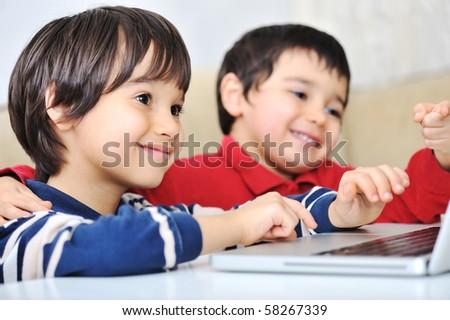Happy boys on laptop - stock photo