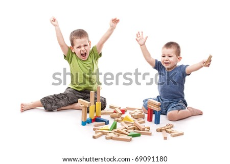 Happy boys playing whit blocks isolated on white - stock photo