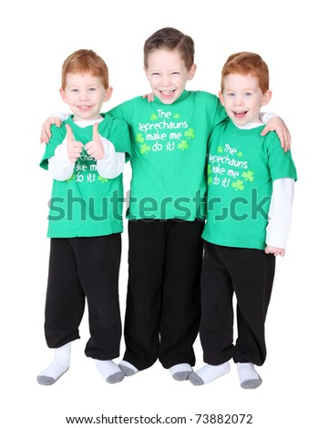 Happy boys smiling facing forwards on white background