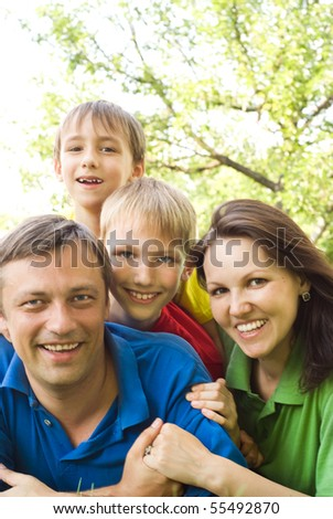 happy boys with family in the summer park - stock photo