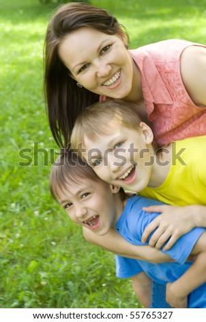 happy boys with mom in the summer park