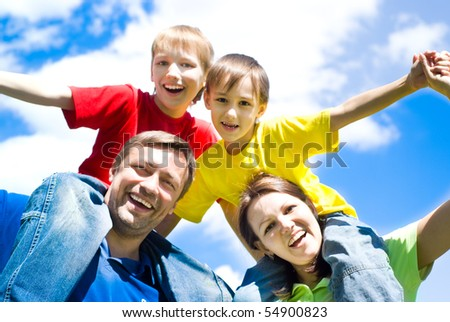happy boys with parents in the summer park - stock photo