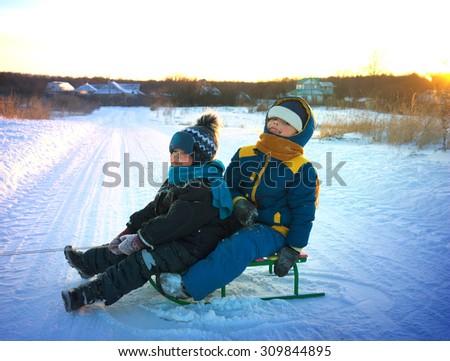 happy boys with sled - stock photo
