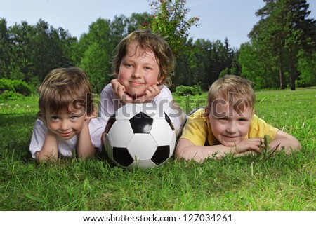 Happy boys with soccer ball - stock photo