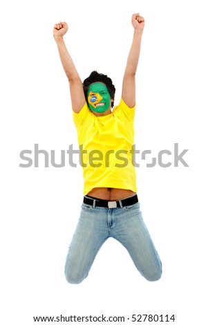 Happy brazilian fan with the flag painted on his face jumping - stock photo