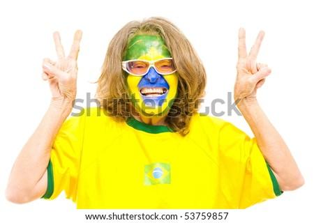 Happy Brazilian sport fan making v of victory - stock photo