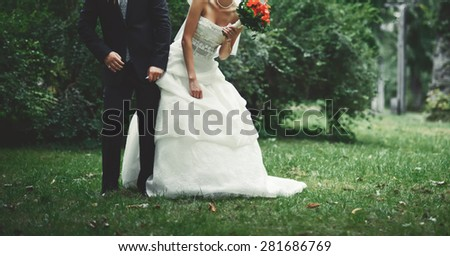 Happy bridal couple in forest. Summer wedding picture.
