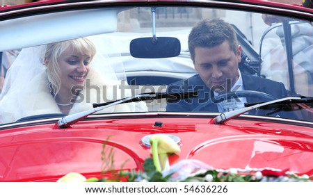 happy bridal couple in the wedding- car - stock photo