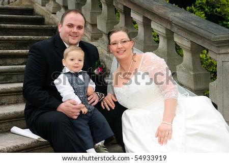 happy bridal couple with child - stock photo
