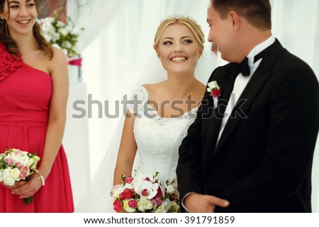 Happy bride and groom and guests on the wedding ceremony - stock photo