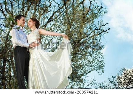Happy bride and groom at the wedding walk - stock photo