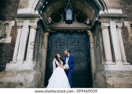 Happy Bride and groom at wedding Day embracing with love. Happy romantic young couple celebrating their marriage - stock photo