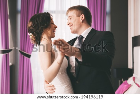 happy bride and groom dancing in bedroom. Bride And Groom Dancing Stock Images  Royalty Free Images