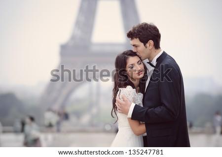 Happy bride and groom enjoying their wedding in Paris - stock photo