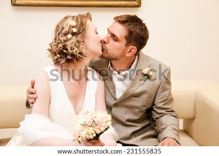 Happy bride and groom kissing - stock photo