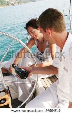 Happy bride and groom on a luxury yacht. - stock photo