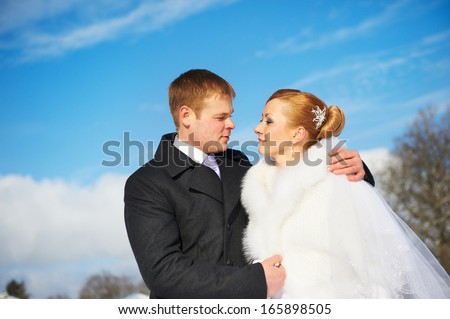 Happy bride and groom on wedding day sky background