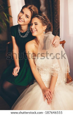 happy bride and her sister - stock photo