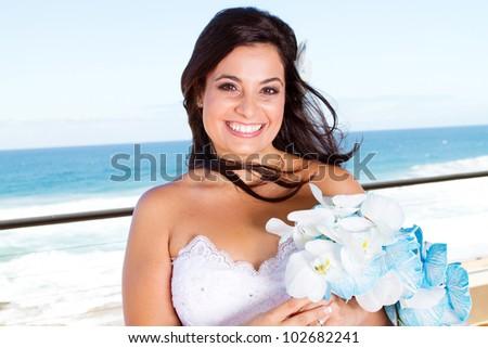 happy bride closeup portrait with bouquet - stock photo