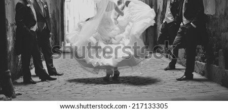 Happy bride dancing around boys. Wedding day  - stock photo
