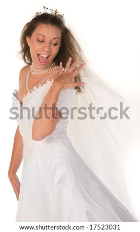 Happy Bride Gawking at Her Large 3 Carat Diamond Engagement Wedding Ring - stock photo