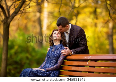 happy bride, groom holding hands in yellow park, kissing, smiling, laughing, embracing. lovers in wedding day. cheerful married couple in love. wedding concept. beautiful people. woman man - stock photo