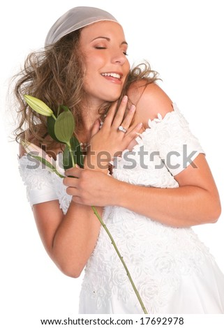 Happy Bride Hugging Herself With Eyes Closed Full of Joy - stock photo