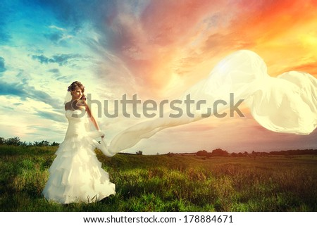 happy bride in a beautiful natural landscape  - stock photo