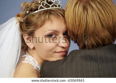 Happy bride put her head on his shoulder groom - stock photo