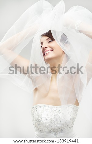 Happy bride smiling, closed eyes, carefree dreaming. Over white - stock photo