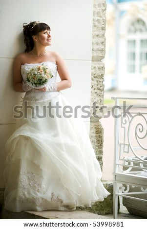 Happy Bride smiling near summer tree outdoors - stock photo